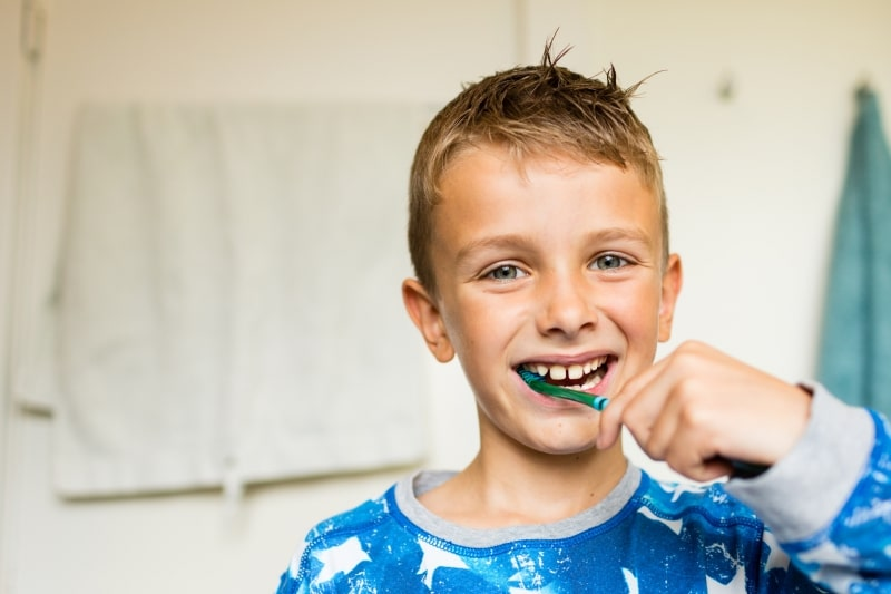 Child practicing good oral health