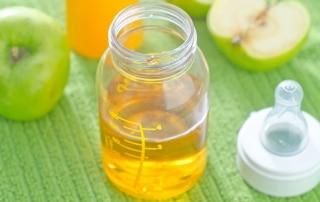apple juice in a baby's bottle