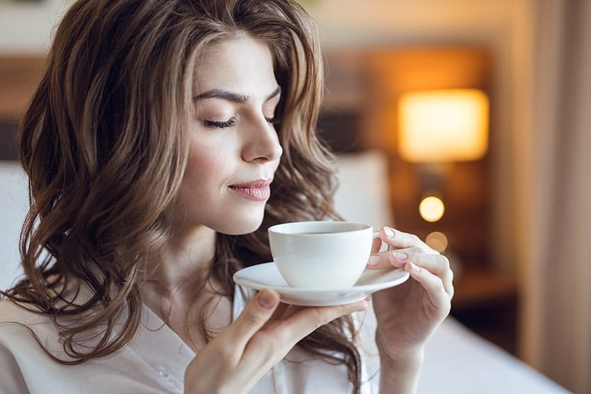 Attractive woman enjoying her coffee in the morning