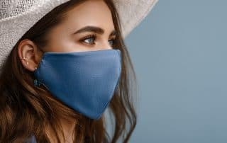 pretty eyes with a COVID-19 mask covering her mouth