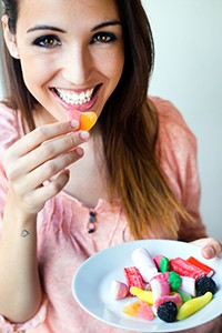 Attractive woman eating chewy candy