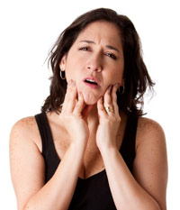 Woman suffering from tmj symptoms: jaw pain & headaches